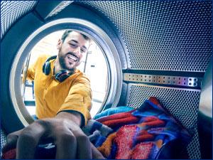 Man reaching into dryer.