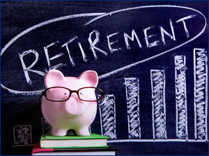 "Piggy bank in front of chalkboard that reads ""Retirement"""