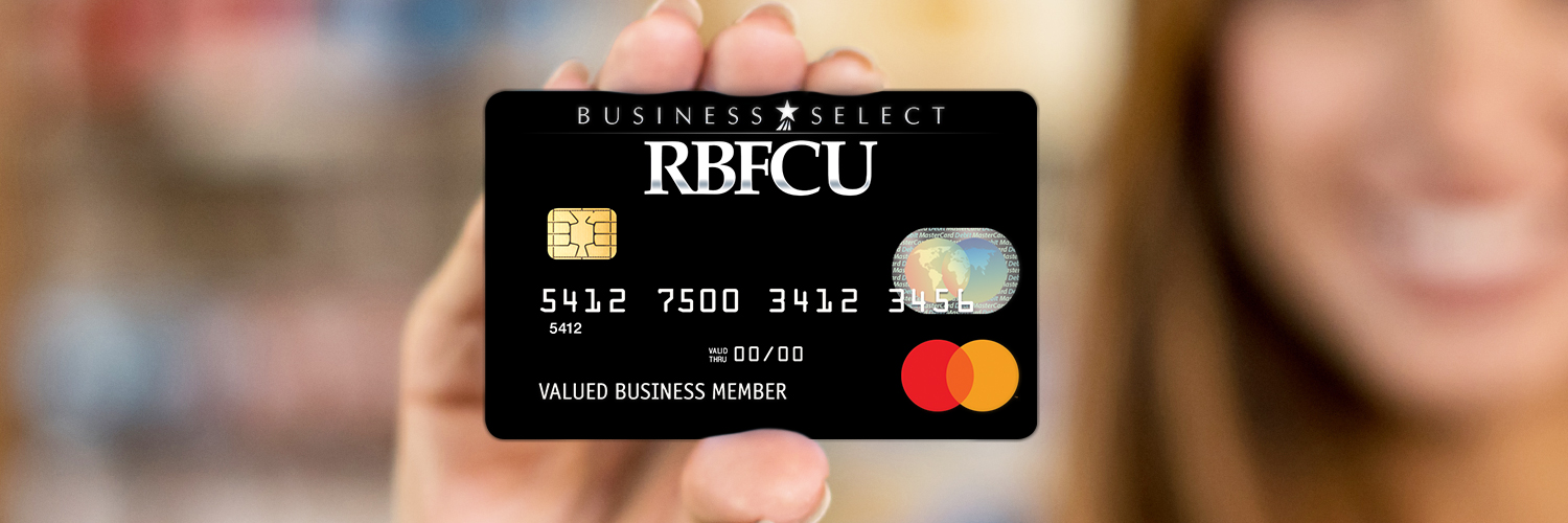 Person holding up RBFCU's Business Select Mastercard