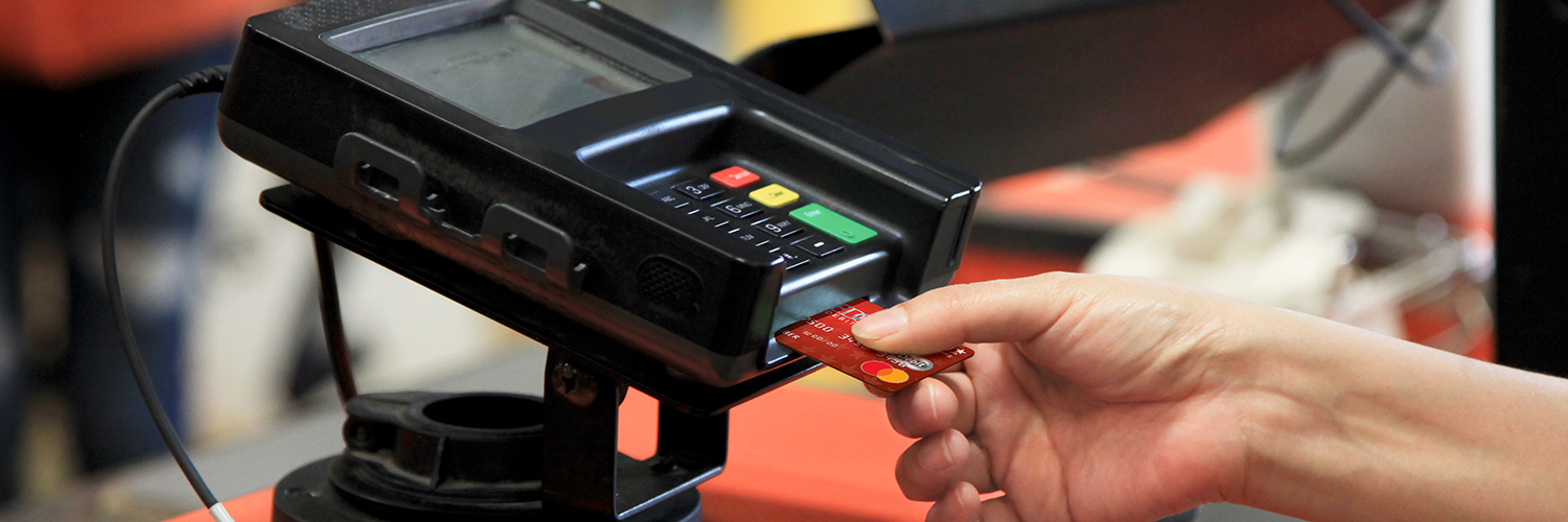 Person completing a credit card transaction