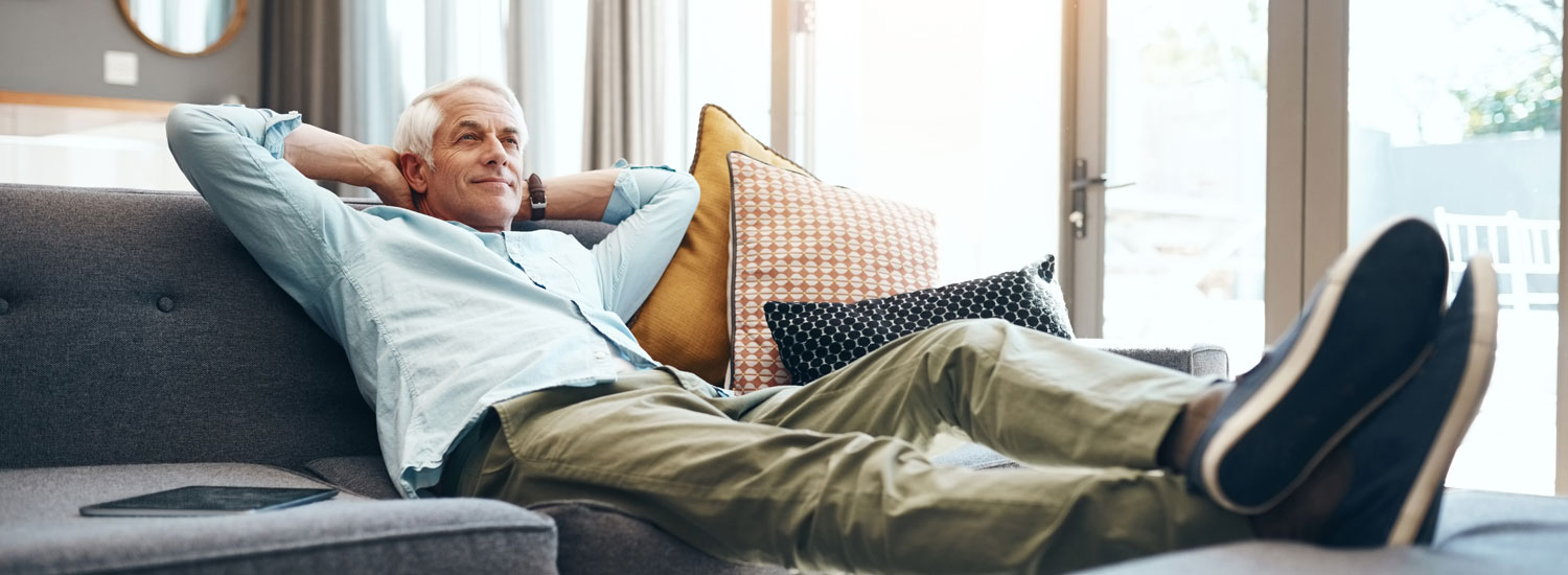 A man relaxing on the couch