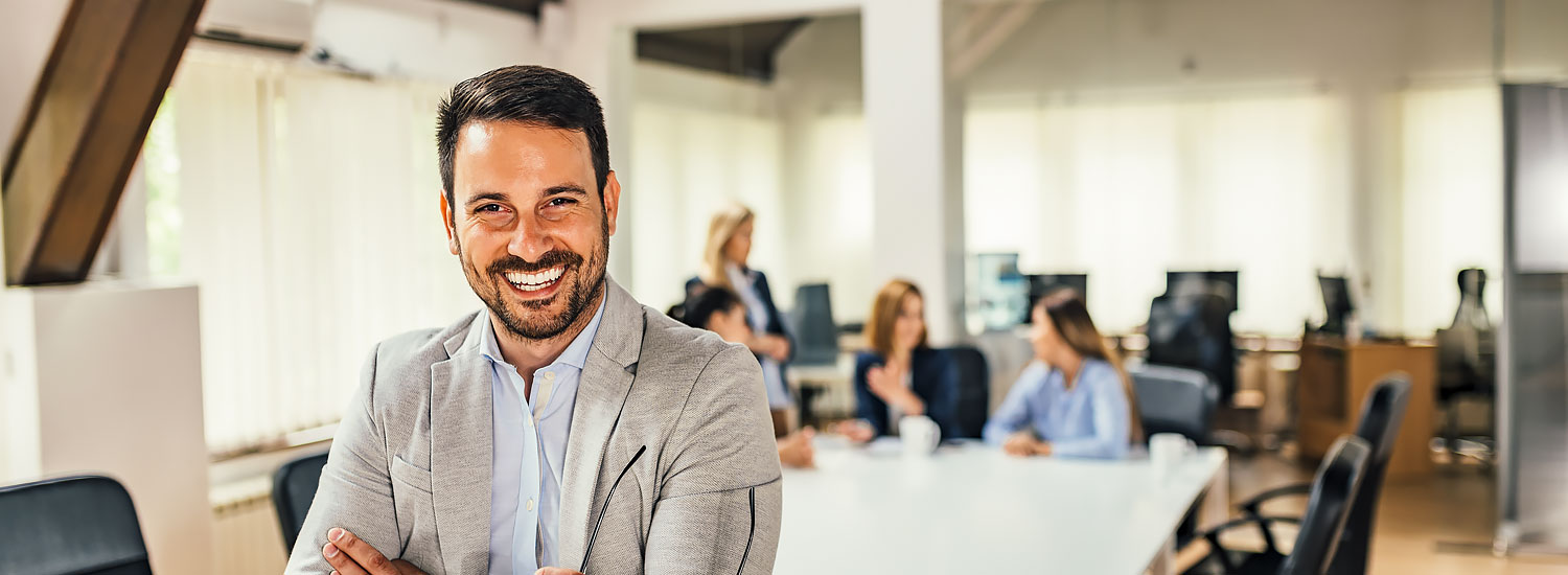 Man at work standing in front of table