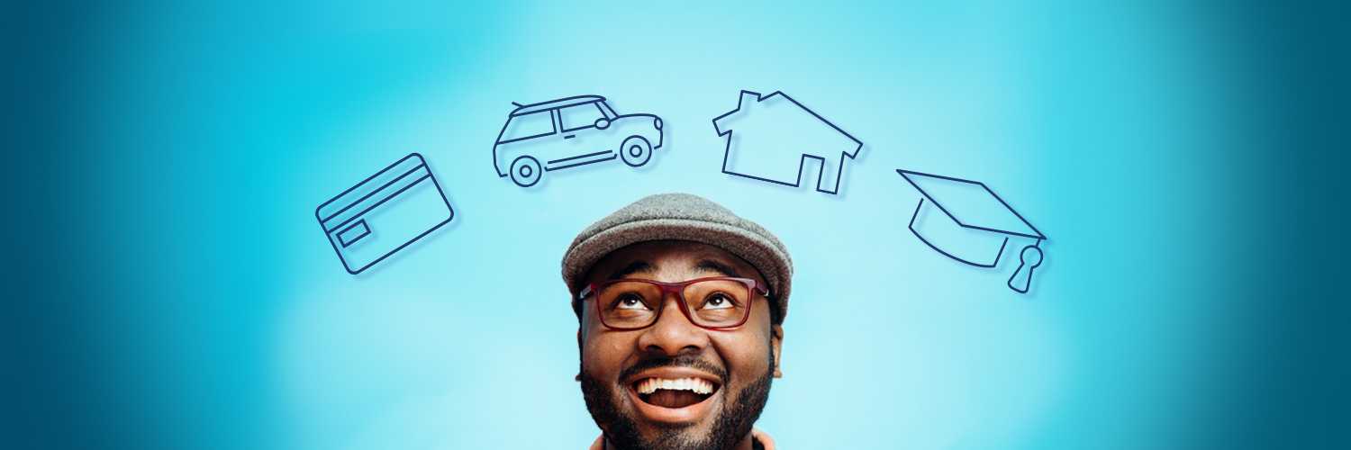 Person looking up at images of credit car, automobile, house and graduation cap