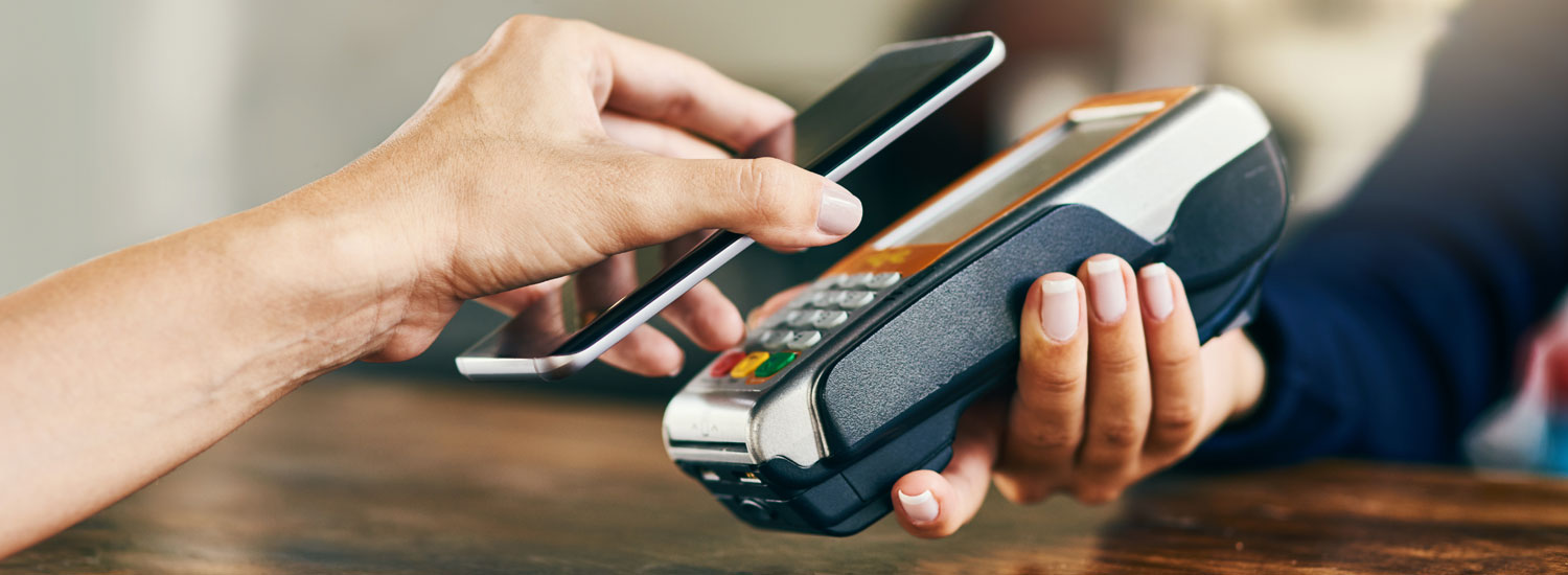 A person paying with their mobile payment service