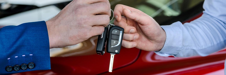 Person handing someone else keys to car