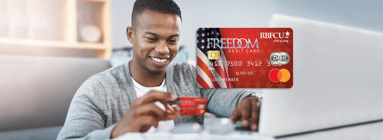 Man holding RBFCU Freedom Debit Card