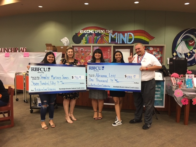 RBFCU Financial Literacy Specialists Jennifer Crawford and Michelle Herrera (second and third from left) present Youth Advisory Council members Jennifer Martinez Jaimes and Adrianna Levy, both seniors at Judson High School, with scholarships on Friday, May 17, 2019.