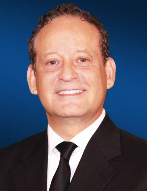 an image ofJohn Rodriguez wearing a black suite and black tie